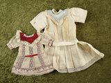 Two muslin Jumeau bebe chemises for Bebe Samaritaine. $400/500