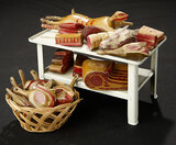 Tinplate Table with Assortment of Carved Wooden Meats, and Basket of Wooden Ducks 600/900