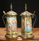 Pair of Austrian Silver Gilt and Enamel Tankards with Figural Finials and Maker's Mark 800/1200