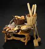 Two Tables Filled with Baskets of Breads 400/600