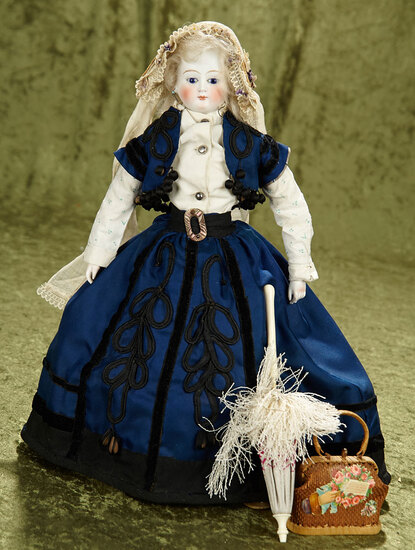 """14.5"""" German bisque fashion poupee with cobalt blue glass eyes in an antique outfit."""