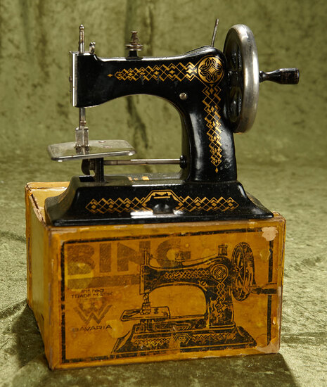 "6.5"" Antique German cast iron child's toy sewing machine by Bing in original box."
