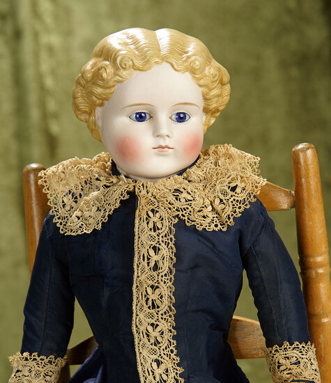 """21"""" German bisque lady with nicely sculpted hair and blue glass eyes on an antique cloth body."""