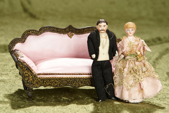 """7"""" German Walterhausen sofa with rose silk upholstery and two dollhouse dolls. $500/800"""