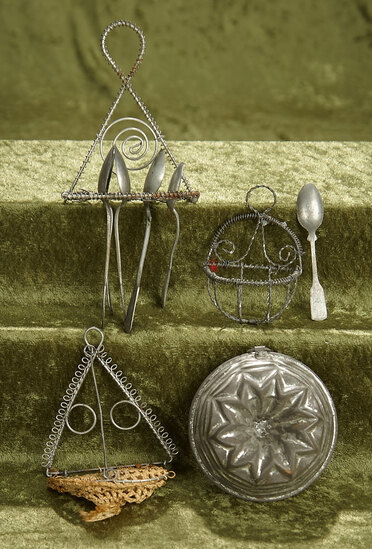"3"" diam. mold.  Four German pressed tinware kitchenware including rare spoon set. $500/700"