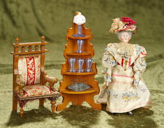 """6"""" German bisque dollhouse lady with etagere of glassware and silk upholstered chair. $500/700"""