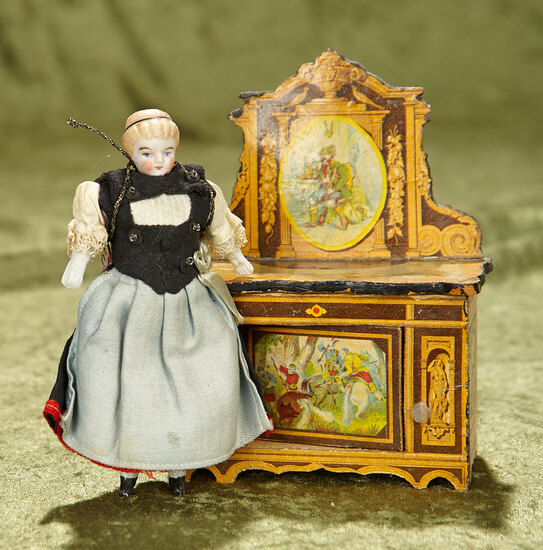 """4 1/2"""" German bisque dollhouse doll and wooden chest with paper lithographed scenes. $300/400"""