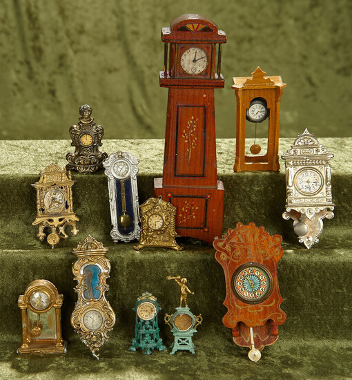 """8"""" tall case clock. Twelve wooden and metal dollhouse clocks in various styles. $400/500"""
