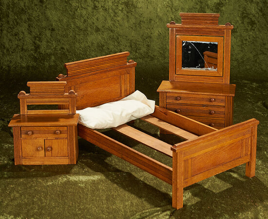 """9""""-22"""" Suite of antique oak doll furniture with bed, wash stand and chest of drawers."""