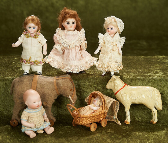 """2""""-5"""" Group of all-bisque miniature dolls along with toy lamb and elephant"""