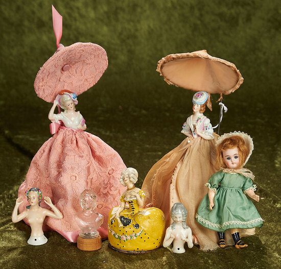"""3""""-11"""" Group of porcelain half-dolls, powder and lotion jars and a small German bisque Kestner doll."""
