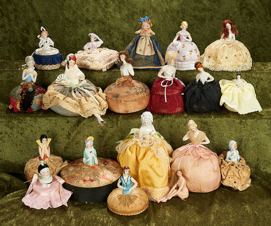 """3""""-7"""" Group of porcelain half-dolls, pin cushions, dresser boxes, powder jar and Bathing Beauty."""