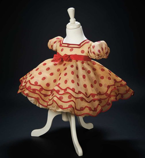 "The Iconic Red Polka Dot Dress Worn by Shirley Temple in 1934 Film ""Stand Up and Cheer"" $20,000+"
