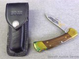 Buck Model 112X lock back knife with belt pouch. Tribute to Chequamegon Sportsman Association 1990,
