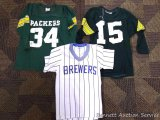 Green Bay Packers shirts size Youth S, and M; Milwaukee Brewers shirt, Youth M. All shirts are worn.