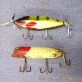 Injured minnow fishing lure with glass eyes has 4