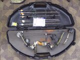 2003 Precision Shooting Equipment compound bow, accessories and case. Bow has 30
