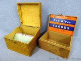 Two wooden boxes with hinged lids. Includes Rum River Quality Crooks box with box joints. Largest is