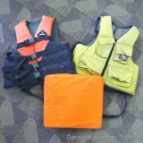Adult L/XL life vest; Stearns life vest; Stearns boat cushion.