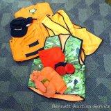 Cabela's blaze orange hunting vest, size L regular; two other vest; mittens; hats.