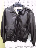 American Born leather flight jacket, size L. Has zipper front with snap flap, four front pockets,