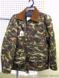 Carhartt insulated camouflage hunting jacket with removeable bag on back. Size Large. Has button