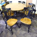 Lovely round table with six matching chairs and two leaves. Table is 45