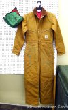 Carhartt insulated coveralls, 34 regular, appears new; two insulated hard hat liners.