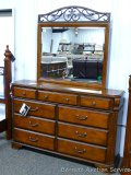 Ashley Signature 9 drawer dresser with mirror. Model B429. Approx. 64