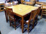 Brooks 7 pc pub height dinette set. Table has leaf that folds down in table. Table model 215454,