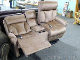 Mega Motion power lift loveseat with console. Has brushed fabric upholstery. It reclines and has