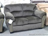 Ashley Signature love seat, Model 3340138. Love seat has brushed upholstery. Matches lot 949.