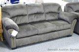 Ashley Signature sofa, Model 3340135. Sofa has brushed upholstery. Matches lot 948.