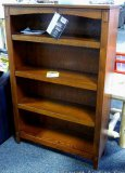 Ashley Signature 4 shelf bookcase. Model H319-K. Has adjustable shelves. 34