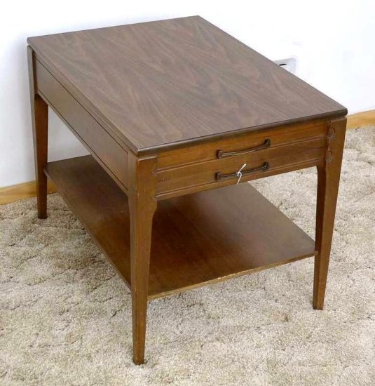 "Mersman end table measures approx. 27"" x 19"" wide x 21"" high and has one dove tailed drawer. Table"