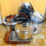 Large aluminum stock pot; saucepans; lids; enameled fry pans; glass baking dishes; frying pans;
