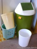 Retro garbage can with swing top lid, plus a few small cans.
