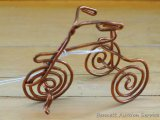 Really cool bent copper wire tricycle is about 3-1/2