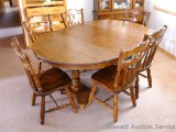 Nice dining table by Walter of Wabash, Wabash, Indiana has two leaves and six chairs. Table with