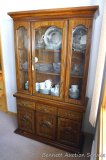 Broyhill china cabinet is in very good condition. Top cabinet removes for easy transport and has two