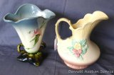 Two Hull pottery pieces have floral designs. Blue rimmed vase is marked 'Hull W16 - 8-1/2