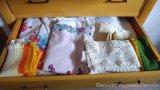 Vintage linens including tablecloths, bridge set, doilies, placemats, more.