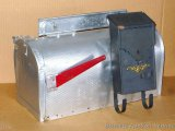 Sturdy steel mail box is nearly two feet long and is in good shape with some dings around opening