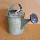 Grandma's galvanized watering can with original metal diffuser head, stands over a foot tall. Solid
