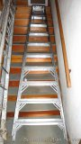 Type I industrial duty 10 foot aluminum step ladder in good condition.