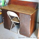 Wooden desk and metal chair appear in good condition with a chip on one corner of the desk. Desk is