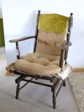 Wooden stationary spring rocker is sturdy and in good shape. Minor wear on arms show that this chair