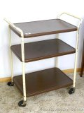 Vintage rolling kitchen cart is sturdy and in good shape. Some painted scratched off on handles,