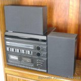 Casio Model MS100A-2 stereo with turntable, tape decks, radio and speakers. Turntable appears unused