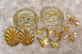 Brass toned wall hangings including butterflies, flowers, shell shaped candle sconces, and 13
